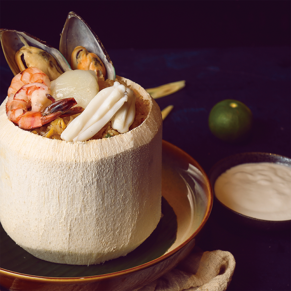 Baked Rice with Seafood in Fresh Coconut